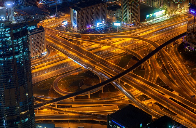 night dubai traffic junction aerial
